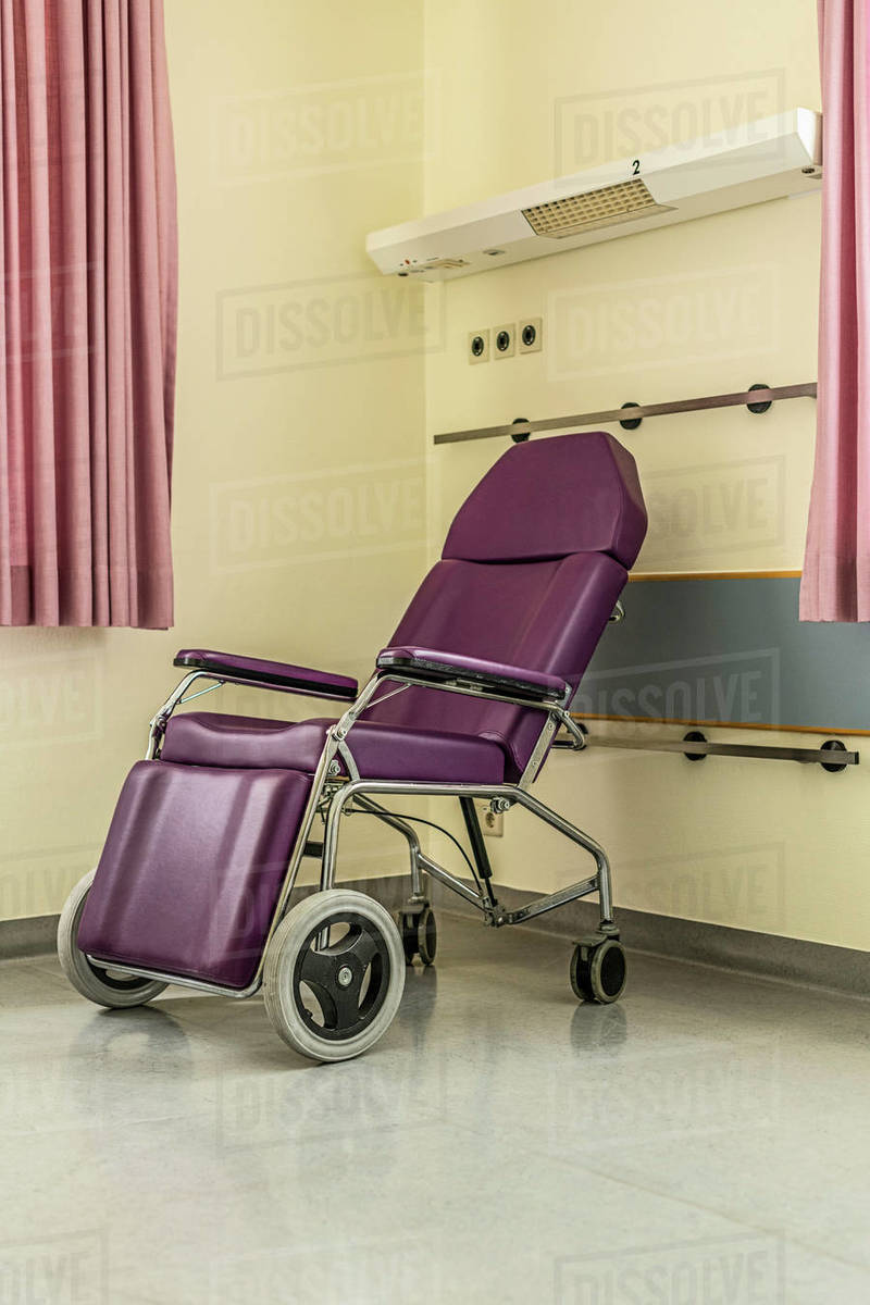 Purple reclining wheelchair in hospital room Royalty-free stock photo