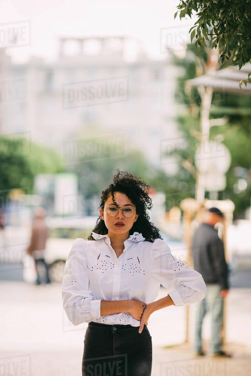 Portrait confident, stylish woman on sidewalk Royalty-free stock photo