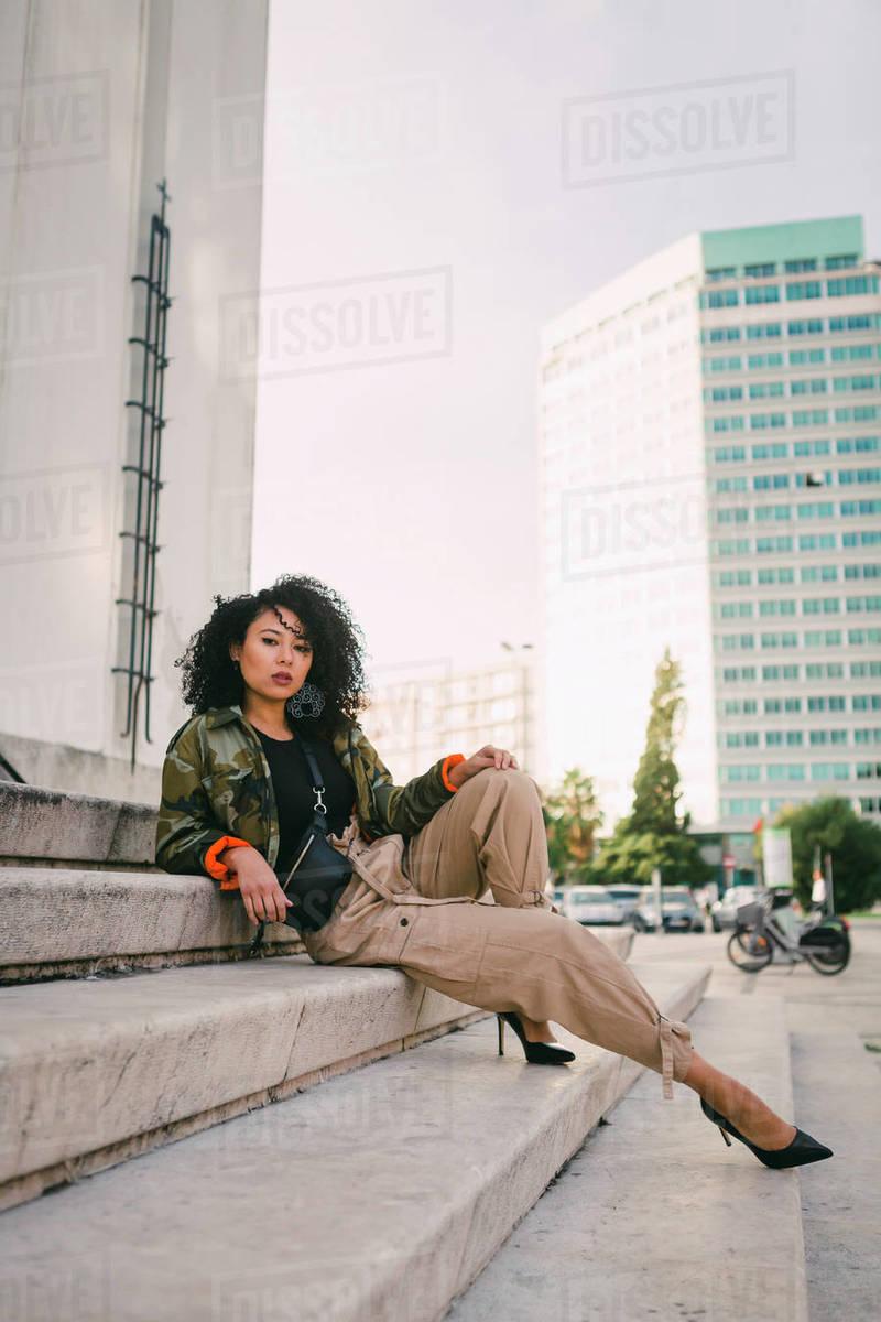 Portrait confident, stylish woman on urban steps Royalty-free stock photo