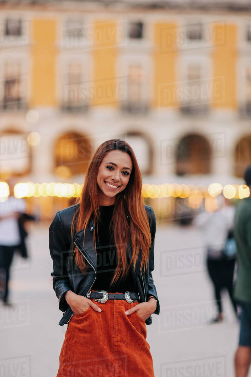 Portrait confident young woman on urban street Royalty-free stock photo