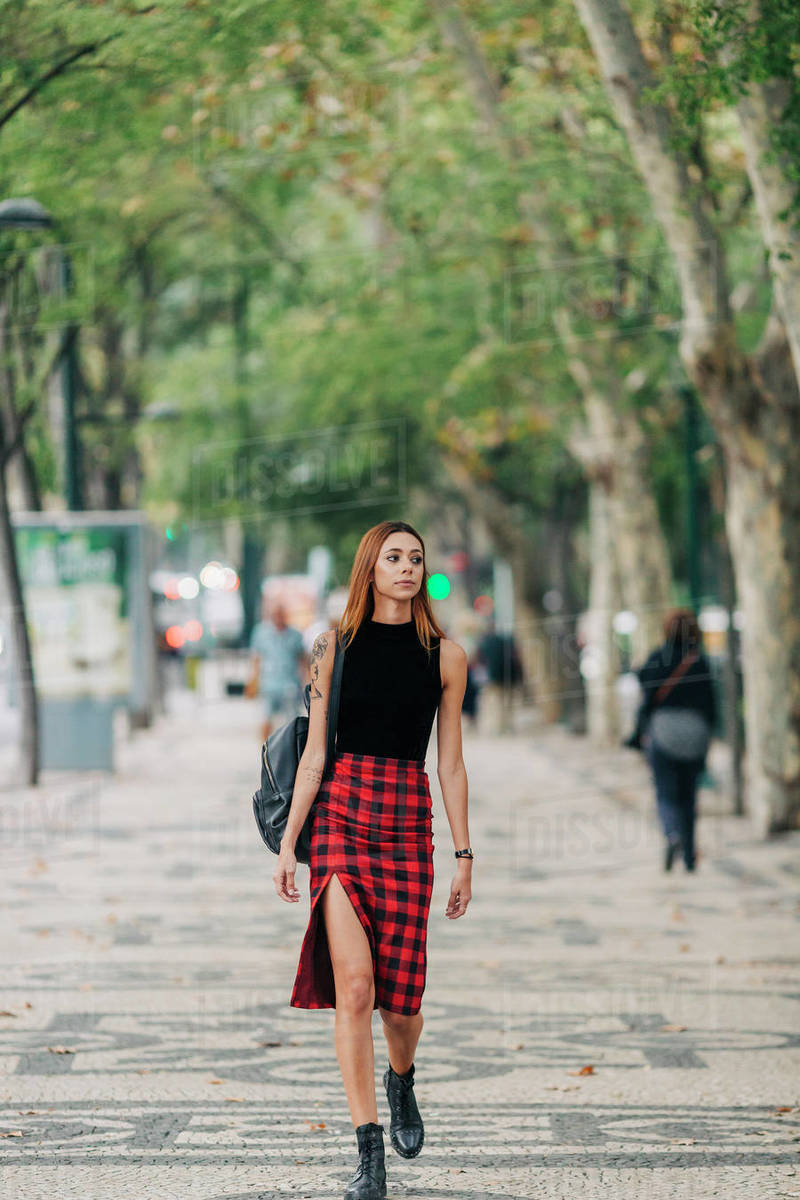 Stylish young woman walking in urban park Royalty-free stock photo