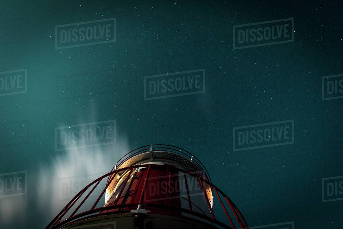 View from below lighthouse under starry night sky Royalty-free stock photo