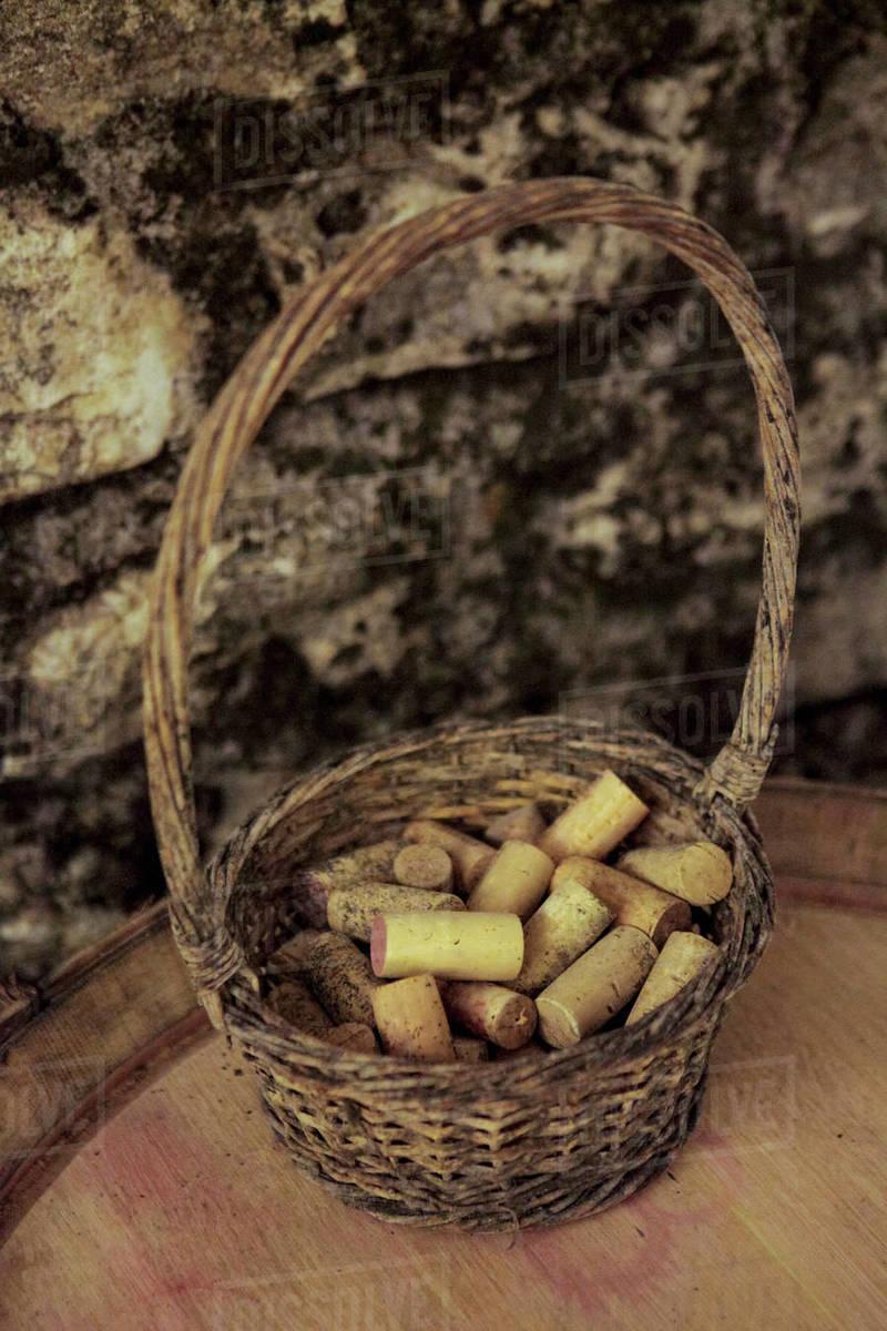 Wine corks in rustic basket on keg Royalty-free stock photo