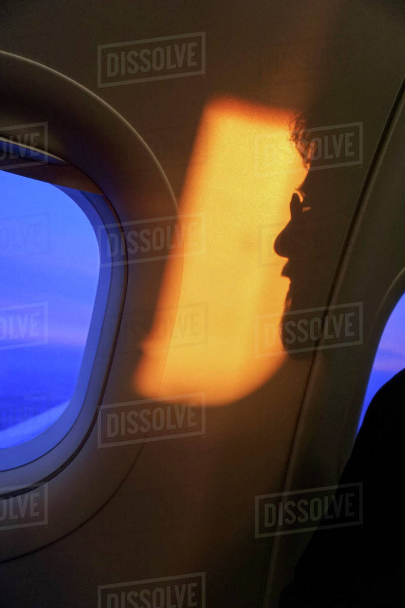 Shadow of man against airplane window Royalty-free stock photo