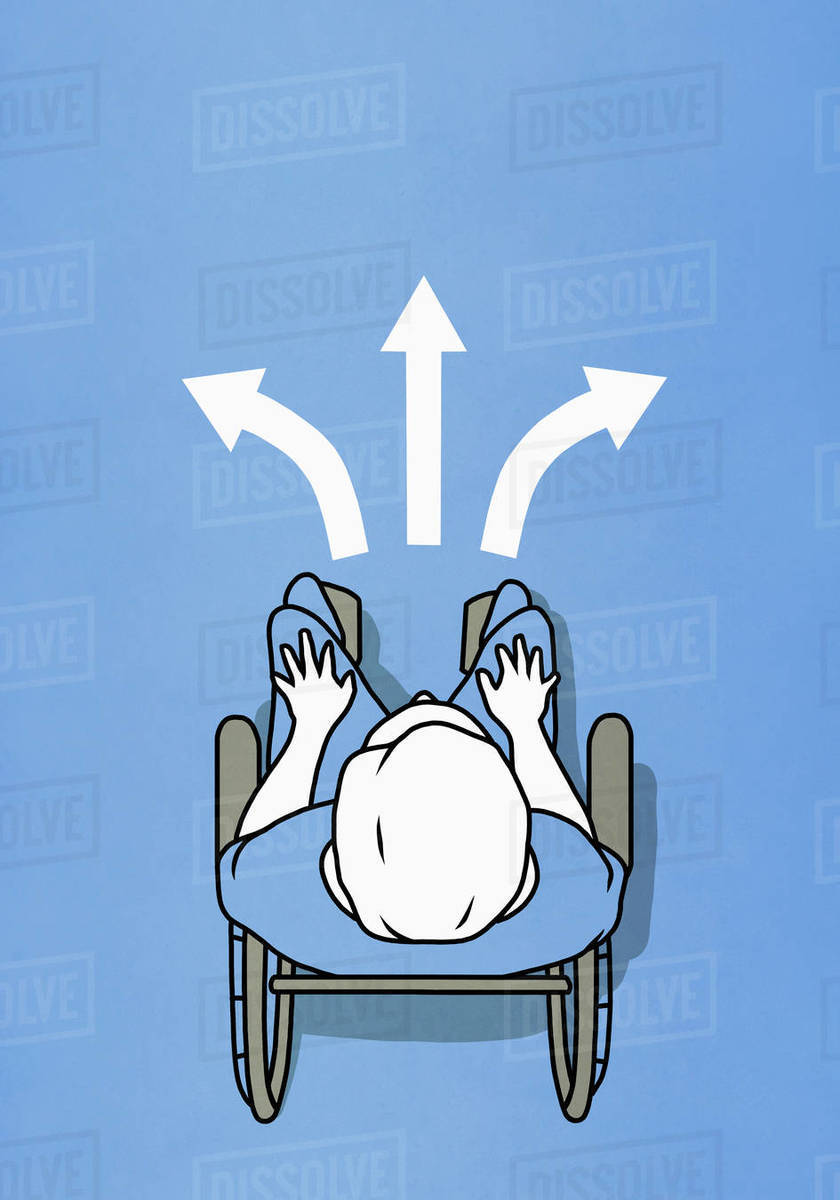Man in wheelchairs stopped at alternating arrows Royalty-free stock photo