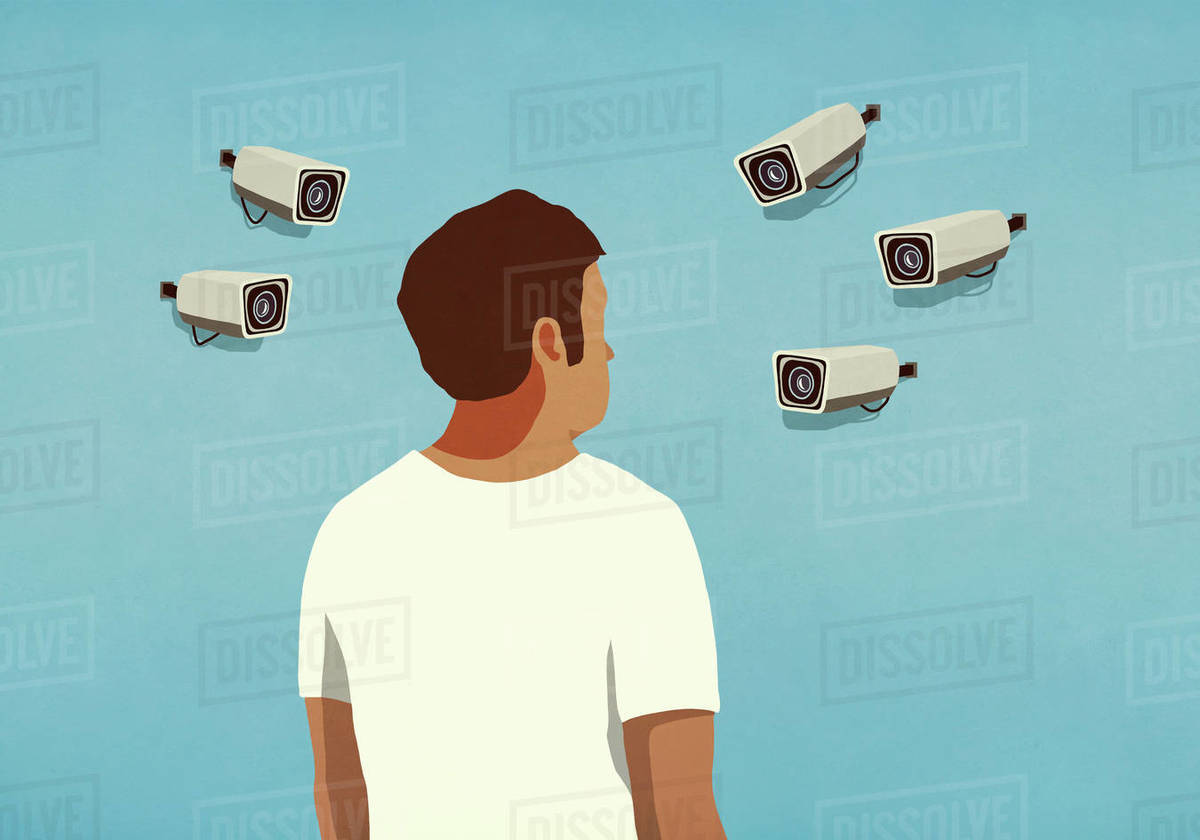 Surveillance cameras pointed at man Royalty-free stock photo