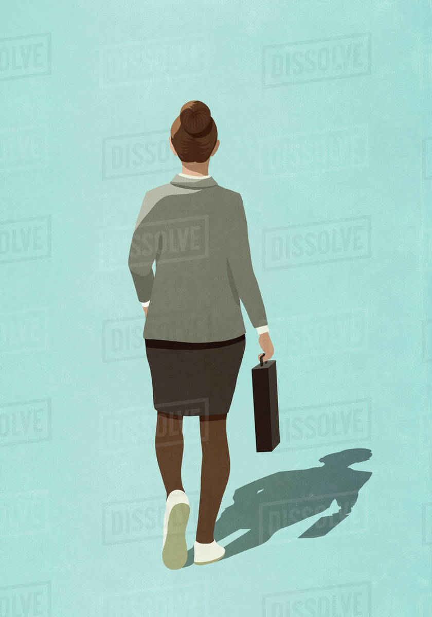 Businesswoman in sneakers walking with briefcase Royalty-free stock photo